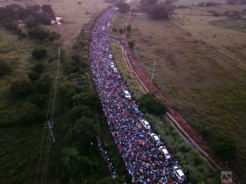 In this Oct. 27, 2018 photo, U.S.-bound Central American migrants cross between the states of Chiapas and Oaxaca after federal police briefly blocked their caravan outside the town of Arriaga, Mexico. Some migrants said they joined the caravan because they felt safer with a group while traversing countries with drug trafficking and gang violence. (AP Photo/Rodrigo Abd)