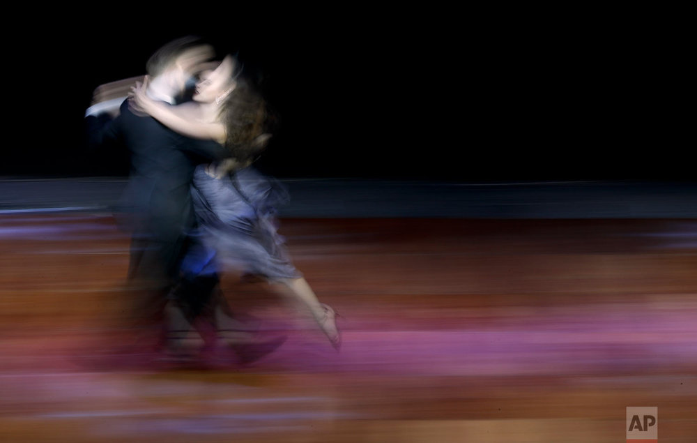 In this Aug. 22, 2018 photo, Argentine couple Maksim Gerasimov and Agustina Piaggio compete in the stage category of the World Tango Championship in Buenos Aires, Argentina. (AP Photo/Natacha Pisarenko)