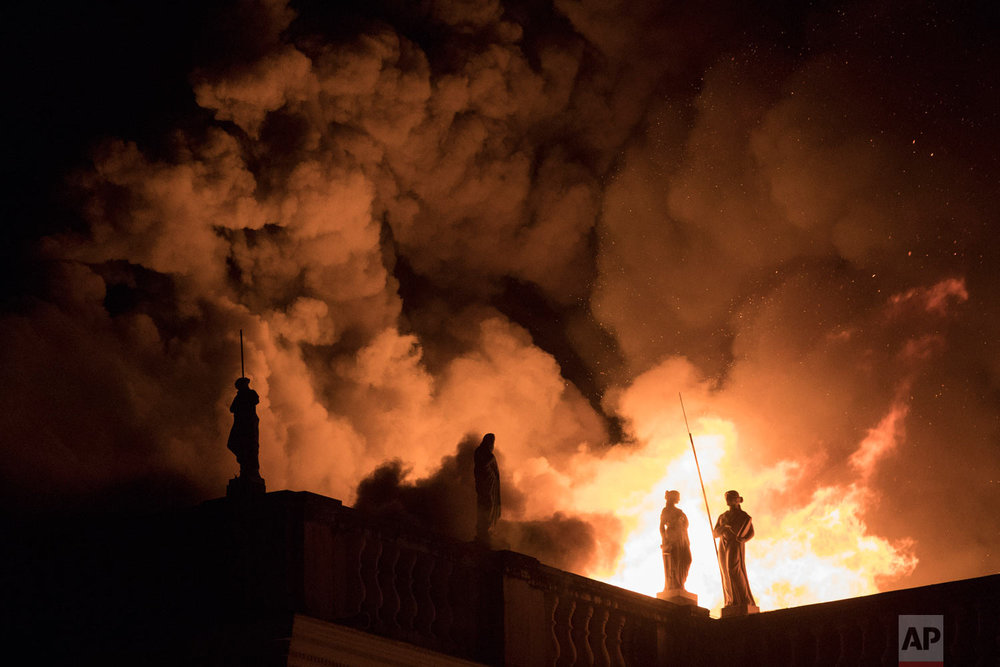 In this Sept. 2, 2018 photo, flames engulf the 200-year-old National Museum of Brazil in Rio de Janeiro, Brazil. The blaze gutted one of the world's oldest museums, destroying much of the 20 million piece collection. (AP Photo/Leo Correa)