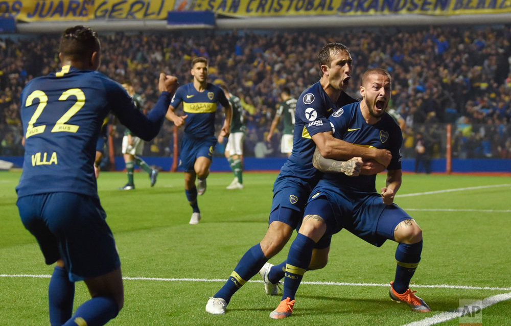 In this Oct. 24, 2018 photo, Dario Benedetto of Argentina's Boca Juniors, right, celebrates his first of two goals against Brazil's Palmeiras during a Copa Libertadores semifinal first leg soccer match in Buenos Aires, Argentina. Boca won 2-0. (AP Photo/Gustavo Garello)