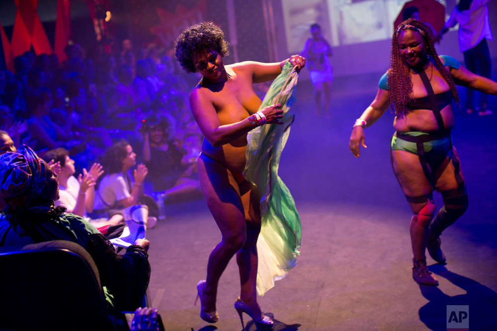 "In this Nov. 18, 2018 photo, sex workers model creations at the Daspu fashion show in Rio de Janeiro, Brazil. Daspu, a wordplay on the expression ""Das putas"" that means ""The hookers"" in Portuguese, is a fashion house founded and run by the city's prostitutes that works for better health, safety and legal conditions for sex workers. (AP Photo/Silvia Izquierdo)"