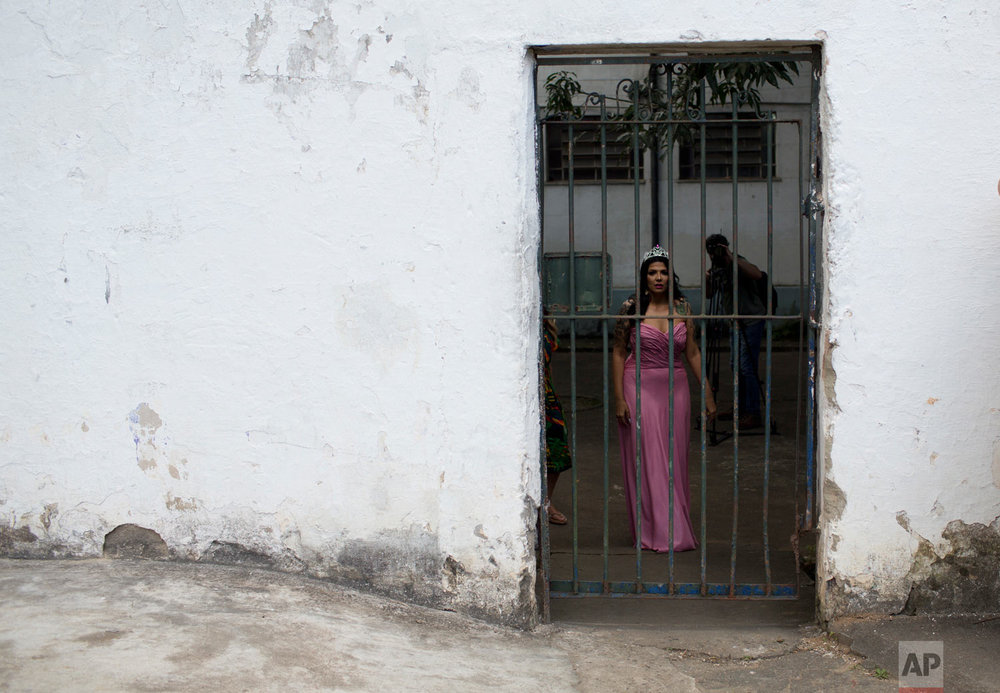 In this Dec. 4, 2018 photo, female prisoner Mayana Rosa Alves wears the crown she won at last year's beauty pageant, before this year's beauty contest at the Talavera Bruce penitentiary in Rio de Janeiro, Brazil. Jail authorities organize the contests to encourage self-esteem, fight idleness and promote integration among women prisoners. (AP Photo/Silvia Izquierdo)