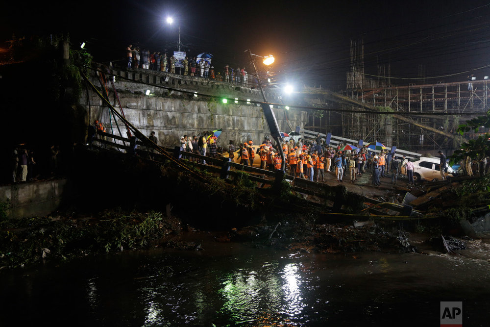 Rescuers work at the scene after a highway overpass collapsed on a sewage canal in Kolkata, India, on Sept. 4, 2018. (AP Photo/Bikas Das)