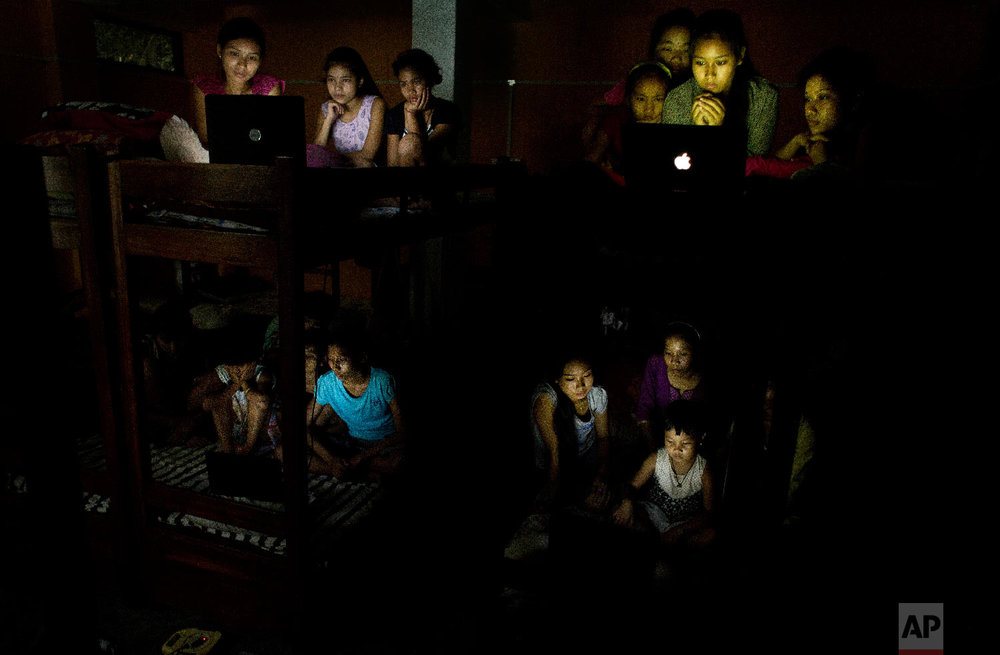 School children watch the World Cup soccer final match between France and Croatia on laptops at a hostel on the outskirts of Gauhati, India, Sunday, July 15, 2018, (AP Photo/Anupam Nath)