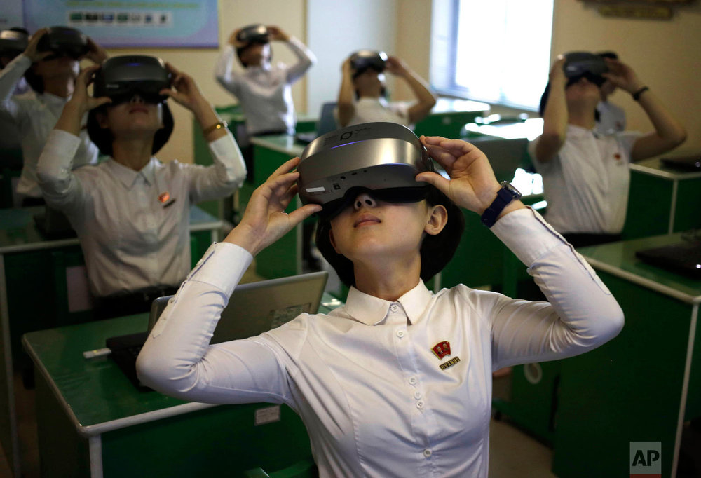 Students wear virtual reality goggles during a science class at Pyongyang Teachers' University, a teacher training college, in Pyongyang, North Korea Thursday, June 14, 2018. (AP Photo/Dita Alangkara)