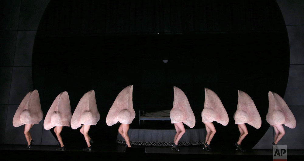 "Dancing noses perform during a dress rehearsal for Shostakovich's opera ""The Nose"" at the Sydney Opera House in Sydney Monday, Feb. 19, 2018. The Nose opens on Feb. 21 and runs until March 3. (AP Photo/Rick Rycroft)"
