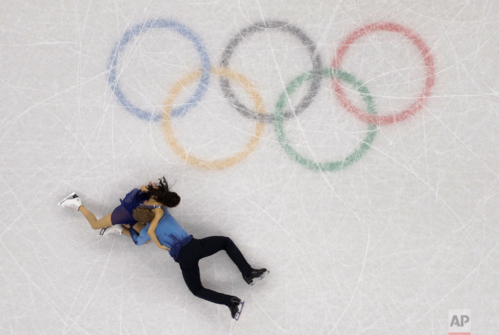 Madison Chock and Evan Bates of the United States fall during the ice dance, free dance figure skating final in the Gangneung Ice Arena at the 2018 Winter Olympics in Gangneung, South Korea, Tuesday, Feb. 20, 2018. (AP Photo/Morry Gash)