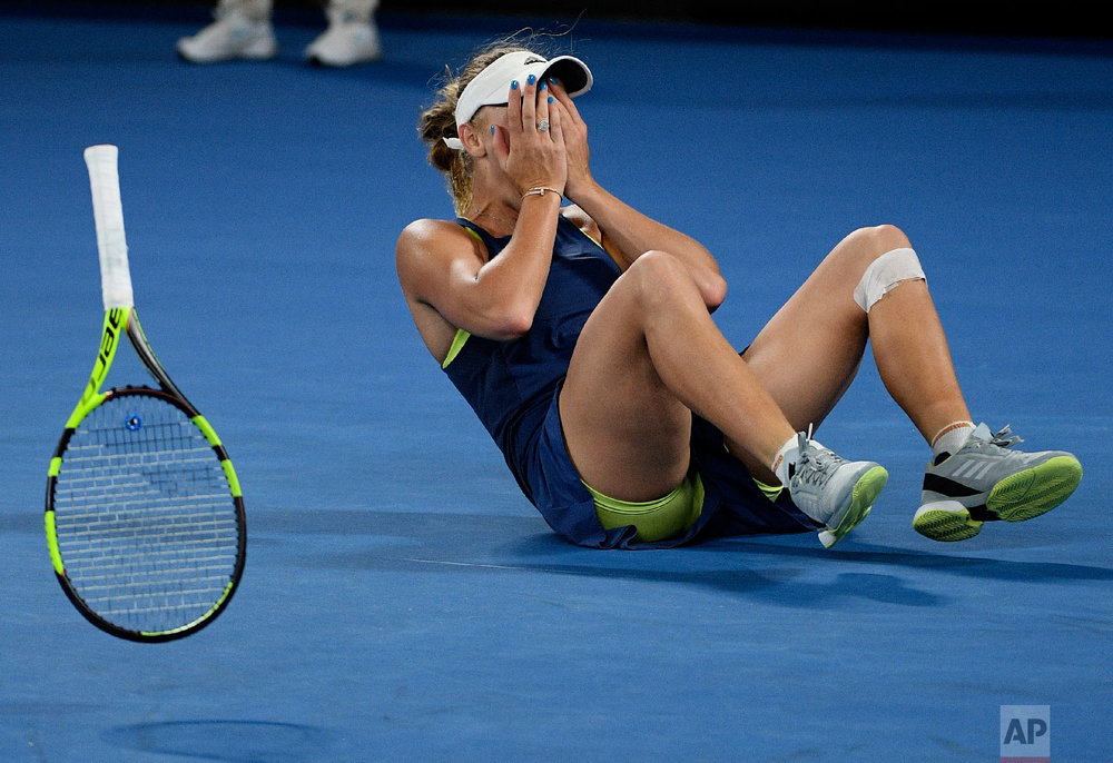 Denmark's Caroline Wozniacki celebrates after defeating Romania's Simona Halep during the women's singles final at the Australian Open tennis championships in Melbourne, Australia, Saturday, Jan. 27, 2018. (AP Photo/Andy Brownbill)