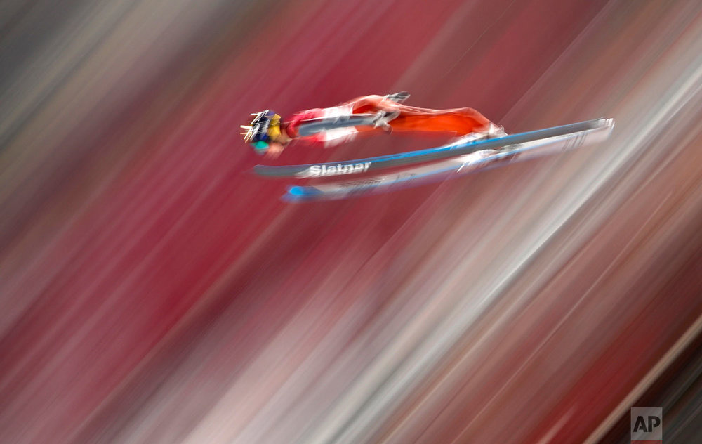 Tilen Bartol, of Slovenia, soars through the air during qualification for the men's large hill individual ski jumping competition at the 2018 Winter Olympics in Pyeongchang, South Korea, Friday, Feb. 16, 2018. (AP Photo/Matthias Schrader)