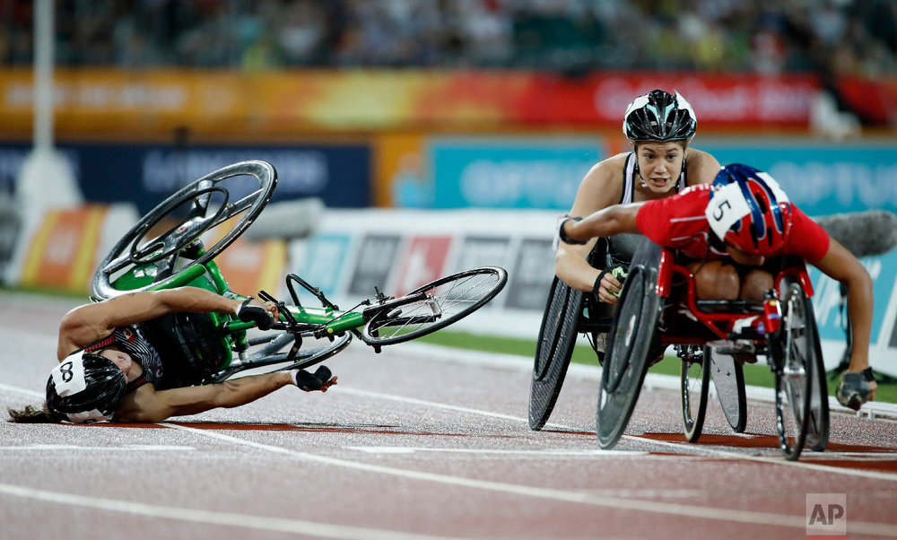 Canada's Jessica Frotten crashes during the women's T54 1500m final at Carrara Stadium during the 2018 Commonwealth Games on the Gold Coast, Australia, Tuesday, April 10, 2018. (AP Photo/Mark Schiefelbein)