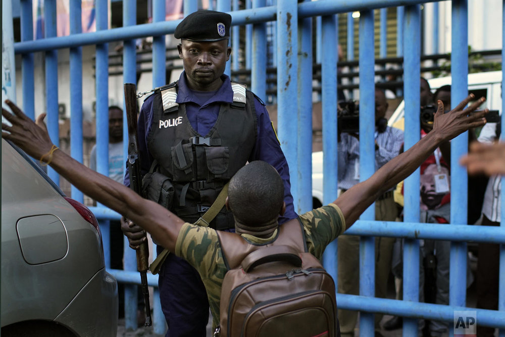 Fiston Adumba, 32, an opposition supporter, reacts to an announcement of postponed elections in Kinshasa, Democratic Republic of the Congo, on Thursday Dec. 20, 2018. The electoral commission has delayed the country's long-awaited presidential election until Dec. 30, citing problems caused by a recent fire that destroyed 80 percent of the voting machines in the capital. (AP Photo/Jerome Delay)