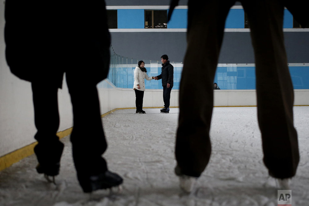 Couples skate on an ice rink in Pyongyang, North Korea, on Tuesday, Dec. 18, 2018. (AP Photo/Dita Alangkara)