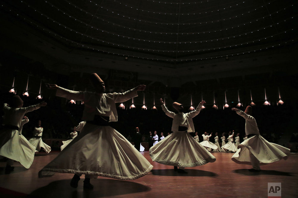 Whirling dervishes of the Mevlevi order perform during a Sheb-i Arus ceremony in Konya, central Turkey on Sunday, Dec. 16, 2018. Every December the Anatolian city hosts a series of events to commemorate the death of 13th century Islamic scholar, poet and Sufi mystic Jalaladdin Rumi. (AP Photo/Lefteris Pitarakis)