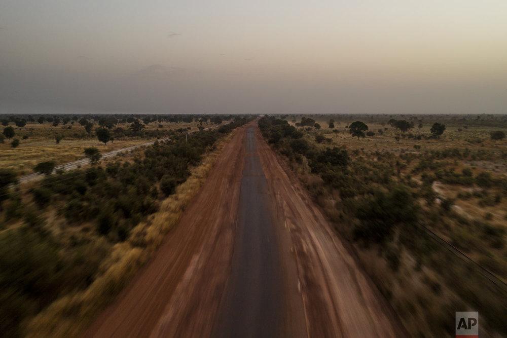 An aerial view of the road that connects Senegal to Mali is seen, Nov. 28, 2018, near Tambacounda, Senegal. (AP Photo/Felipe Dana)