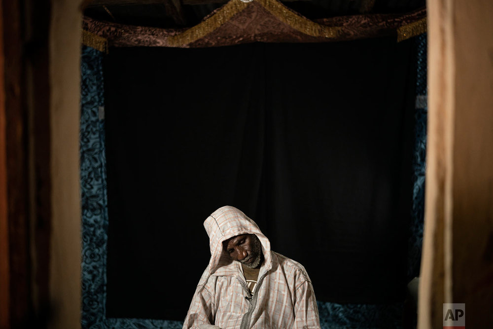 Cheikh Fofana pauses while talking about his missing son during an interview on Nov. 26, 2018, in Goudiry, Senegal. Fofana grieves his son's absence, even while refusing to officially acknowledge he is dead.(AP Photo/Felipe Dana)