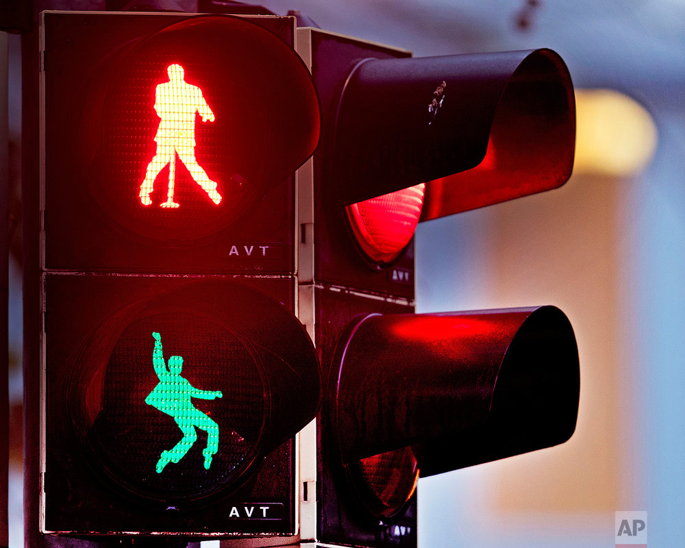 Walking figures depicting late US rock and roll legend Elvis Presley appear on a traffic light switching from green to red in Friedberg near Frankfurt, Germany, Thursday, Dec. 6, 2018. Presley served in Friedberg from October 1958 to March 1960 as a soldier in the US Armed Forces.( AP Photo/Michael Probst)