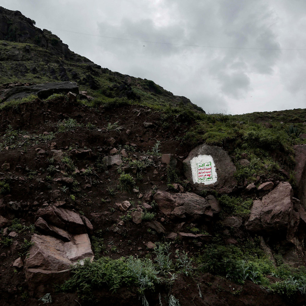 """This Aug. 3, 2018 photo, shows the Houthi slogan with Arabic that reads, """"God is great. Death to America. Death to Israel. Curse the Jews. Victory to Islam,"""" on a mountain in Ibb, Yemen. (AP Photo/Nariman El-Mofty)"""