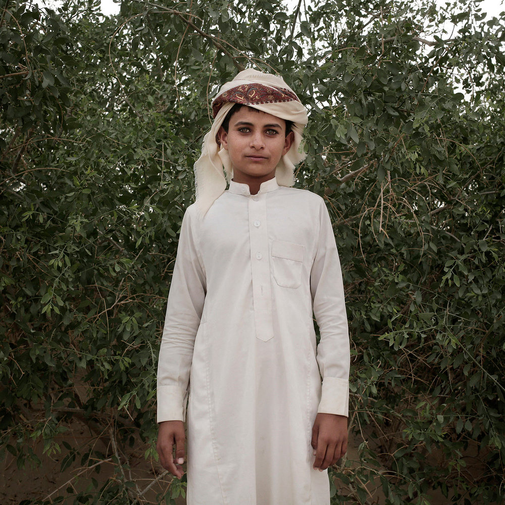 In this July 29, 2018 photo, a boy poses for a photograph at a displaced persons camp in Marib, Yemen. (AP Photo/Nariman El-Mofty)