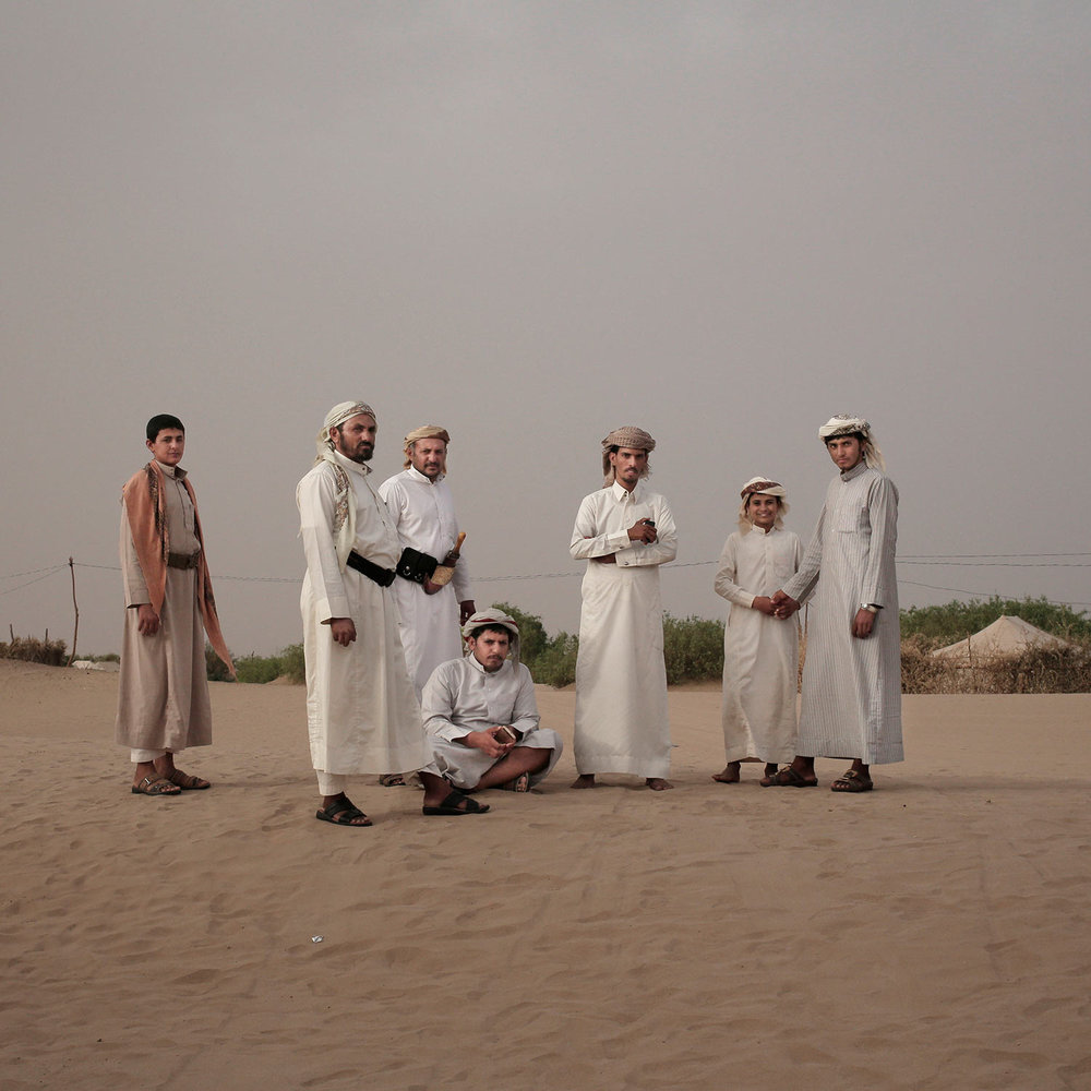 In this July 29, 2018 photo, men stand together at a displaced persons camp in Marib, Yemen, (AP Photo/Nariman El-Mofty)