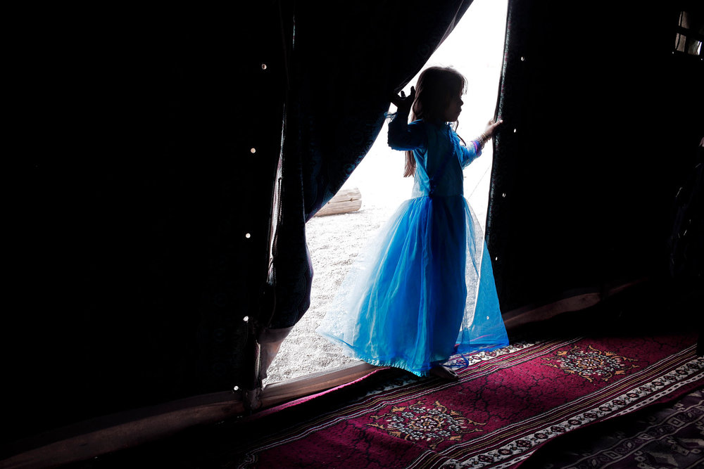 In this July 27, 2018 photo, a Yemeni girl walks into a tent at a camp for displaced persons, in Marib, Yemen. (AP Photo/Nariman El-Mofty)