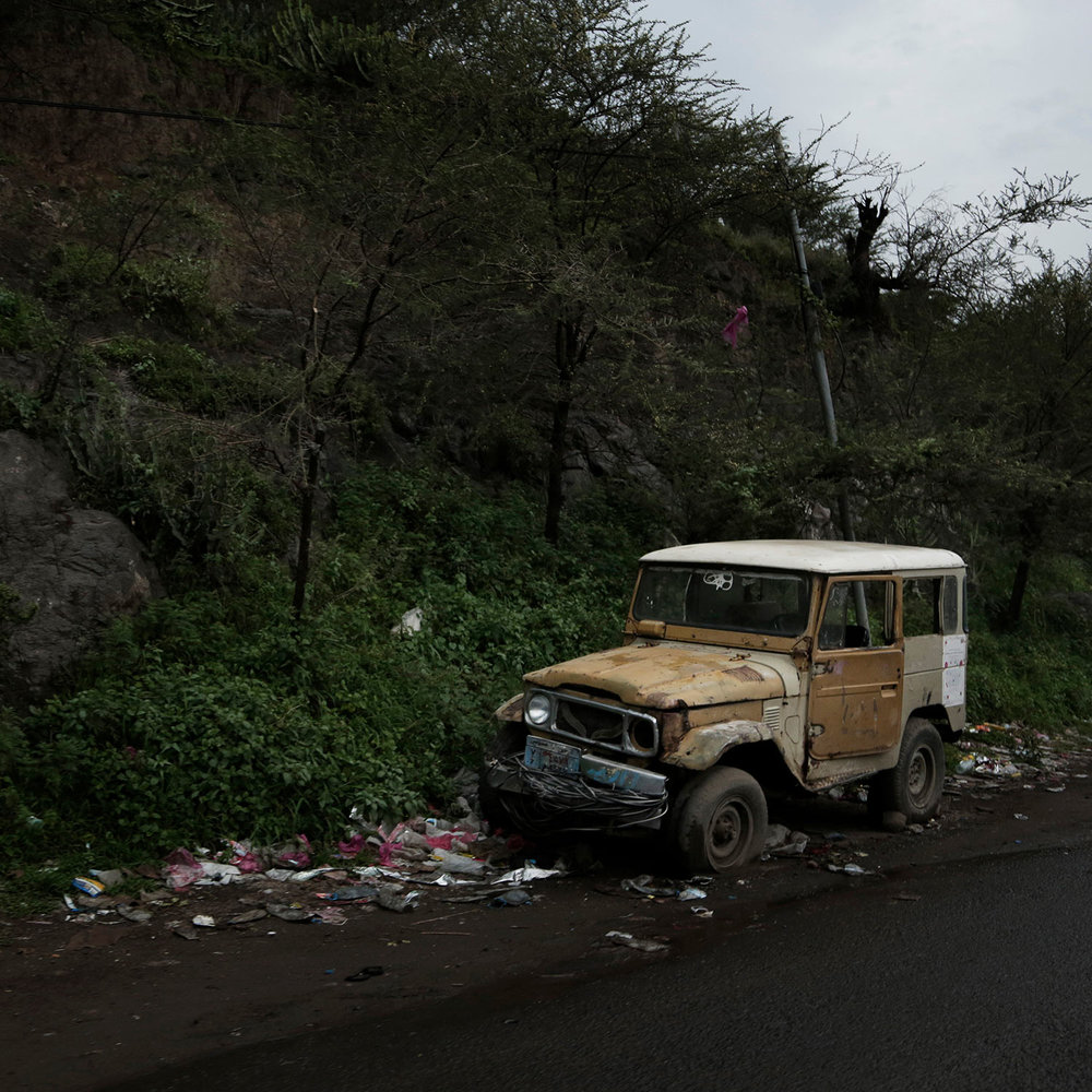 This Aug. 3, 2018 photo, shows a damaged vehicle neglected on the road in Ibb, Yemen. (AP Photo/Nariman El-Mofty)