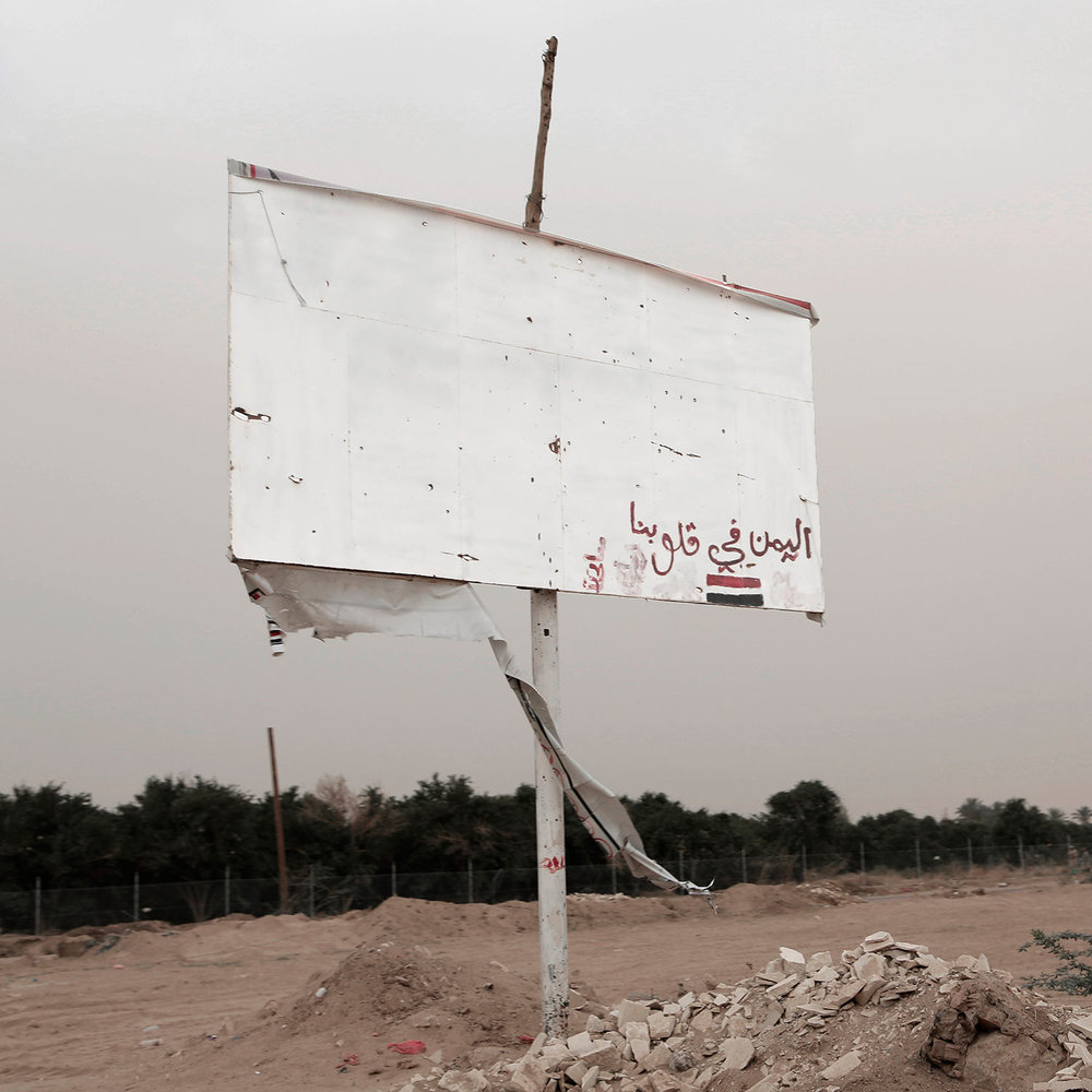 """This July 30, 2018 photo, shows a damaged billboard with Arabic that reads, """"Yemen is in our hearts,"""" in Marib, Yemen. (AP Photo/Nariman El-Mofty)"""
