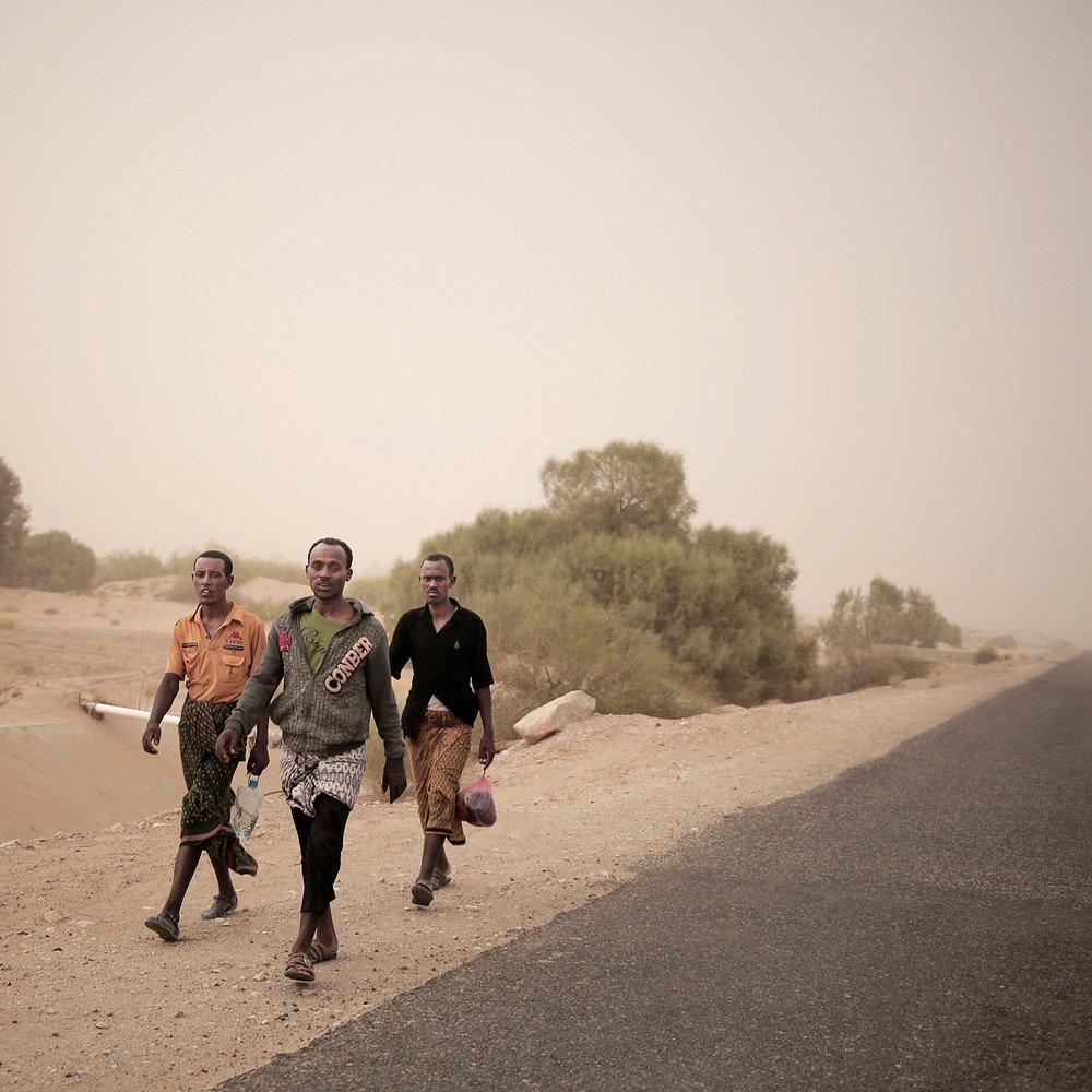 In this July 29, 2018 photo, African migrants walk on a highway in Marib, Yemen. (AP Photo/Nariman El-Mofty)