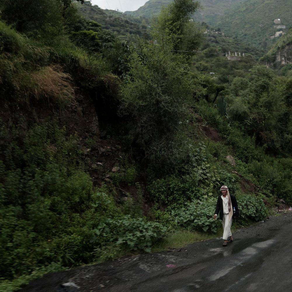 In this Aug. 3, 2018 photo, a man walks on a road in Ibb, Yemen. (AP Photo/Nariman El-Mofty)