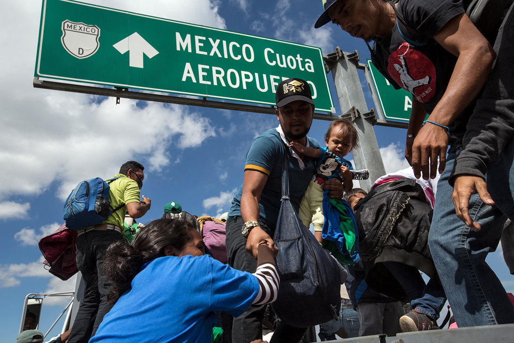 U.S.-bound Central American migrants get on to a truck for a a free ride, as part of a thousands-strong caravan moving through Puebla, Mexico, Monday, Nov. 5, 2018. (AP Photo/Rodrigo Abd)