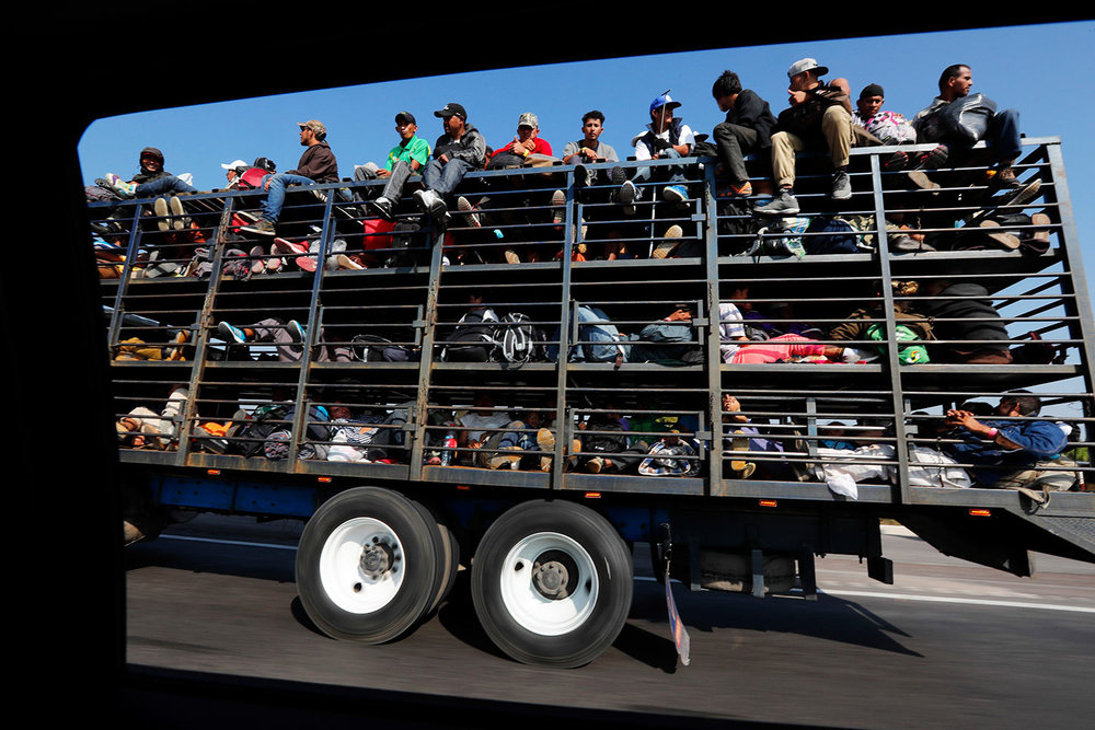 Central American migrants, part of the caravan hoping to reach the U.S. border, get a ride on a truck, in Celaya, Mexico, Sunday, Nov. 11, 2018. (AP Photo/Marco Ugarte)