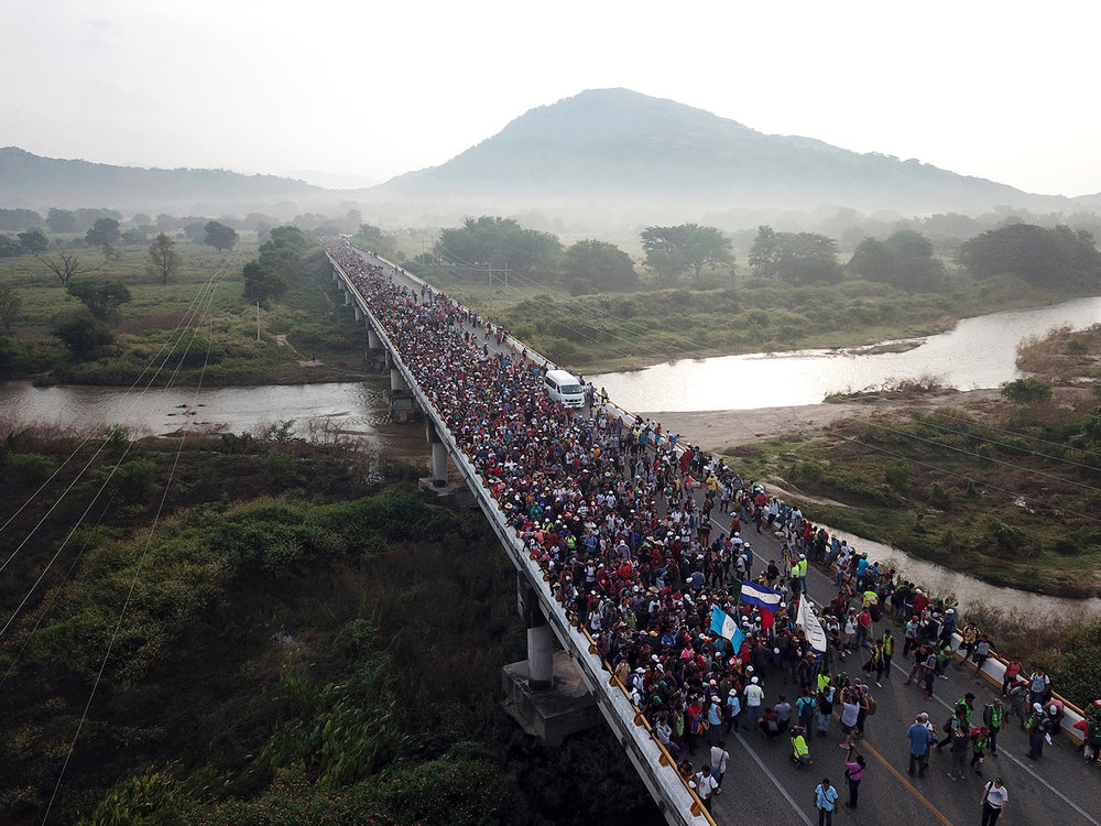 Members of a US-bound migrant caravan cross a bridge between the Mexican states of Chiapas and Oaxaca after federal police briefly blocked them outside the town of Arriaga, Saturday, Oct. 27, 2018.  (AP Photo/Rodrigo Abd)