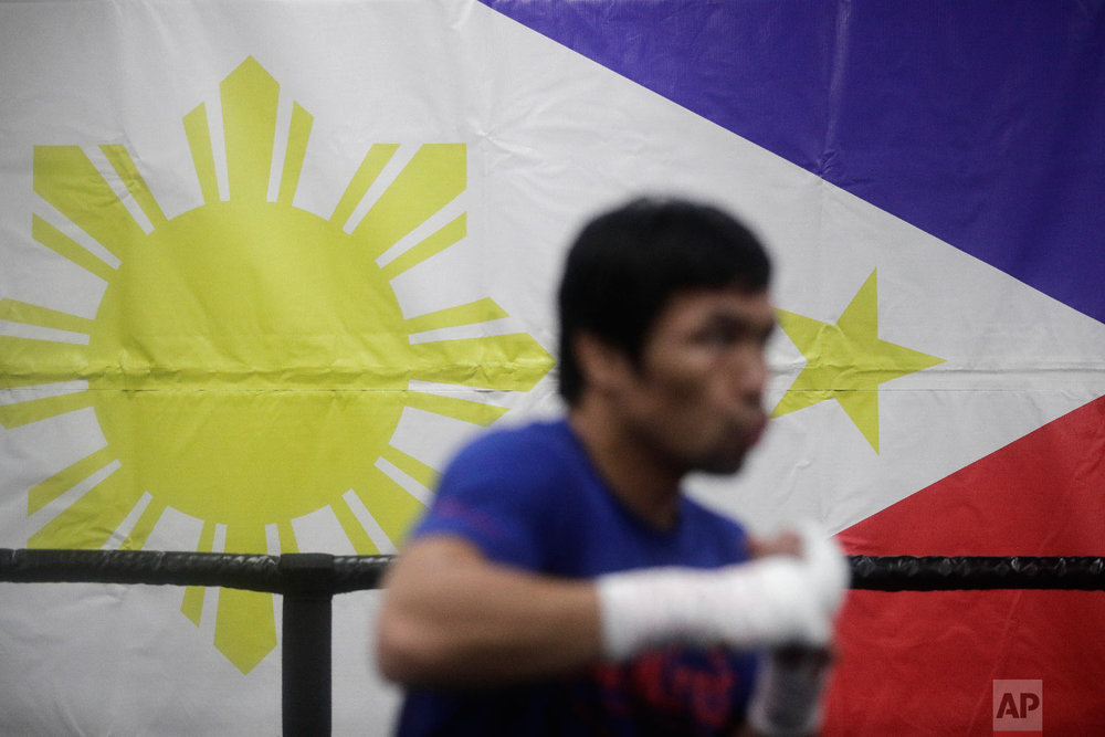Boxer Manny Pacquiao shadow boxes during his workout at the Wild Card Boxing Club on Jan. 14, 2019, in Los Angeles. (AP Photo/Jae C. Hong)