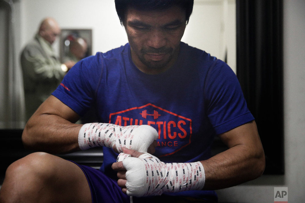 Boxer Manny Pacquiao tapes his hands for a workout at the Wild Card Boxing Club on Jan. 14, 2019, in Los Angeles. (AP Photo/Jae C. Hong)