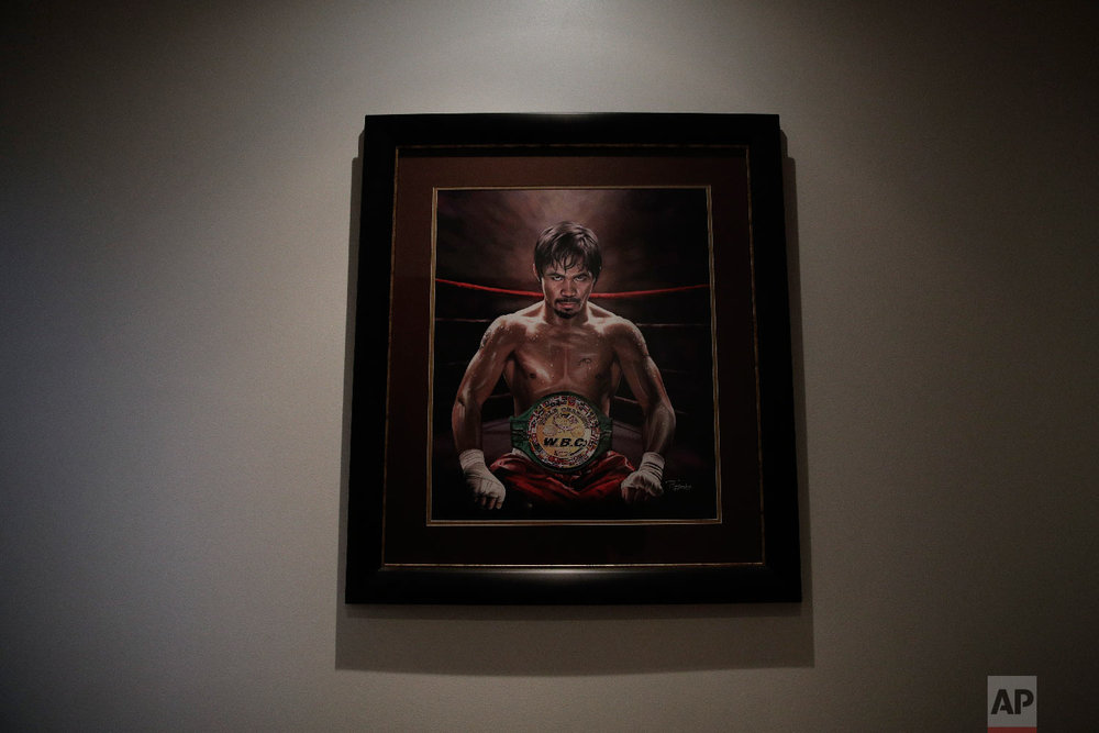 A framed portrait of boxer Manny Pacquiao hangs in the foyer of Pacquiao's home on Jan. 14, 2019, in Los Angeles. (AP Photo/Jae C. Hong)