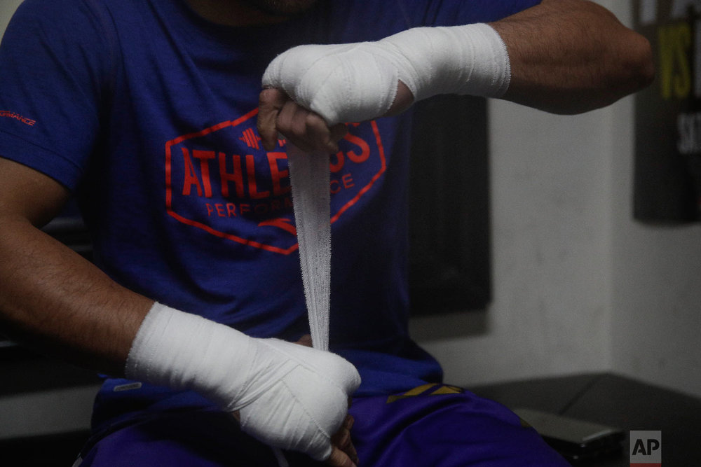 Pacquiao tapes his hands before his workout. (AP Photo/Jae C. Hong)