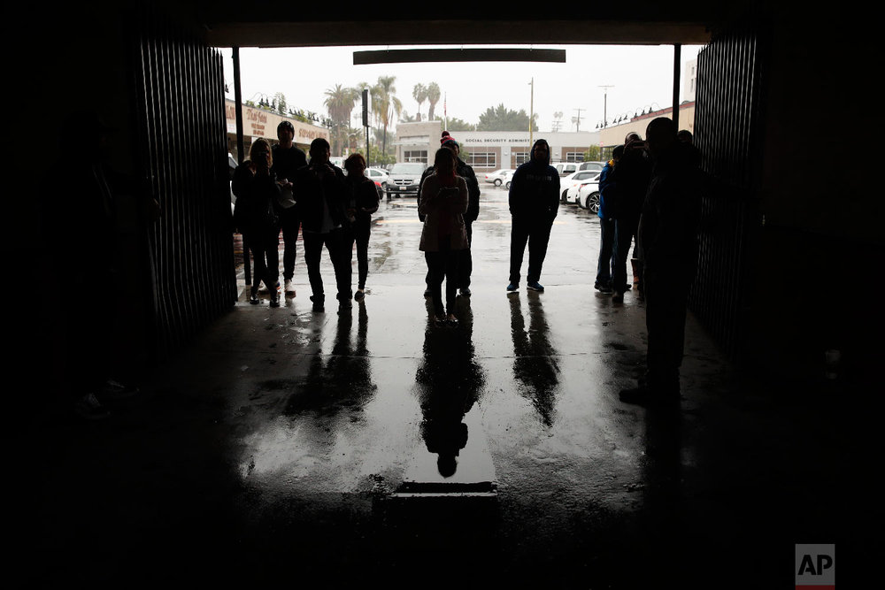 Fans wait outside the Wild Card Boxing Club for a glimpse of boxer Manny Pacquiao, Jan. 14, 2019, in Los Angeles. (AP Photo/Jae C. Hong)
