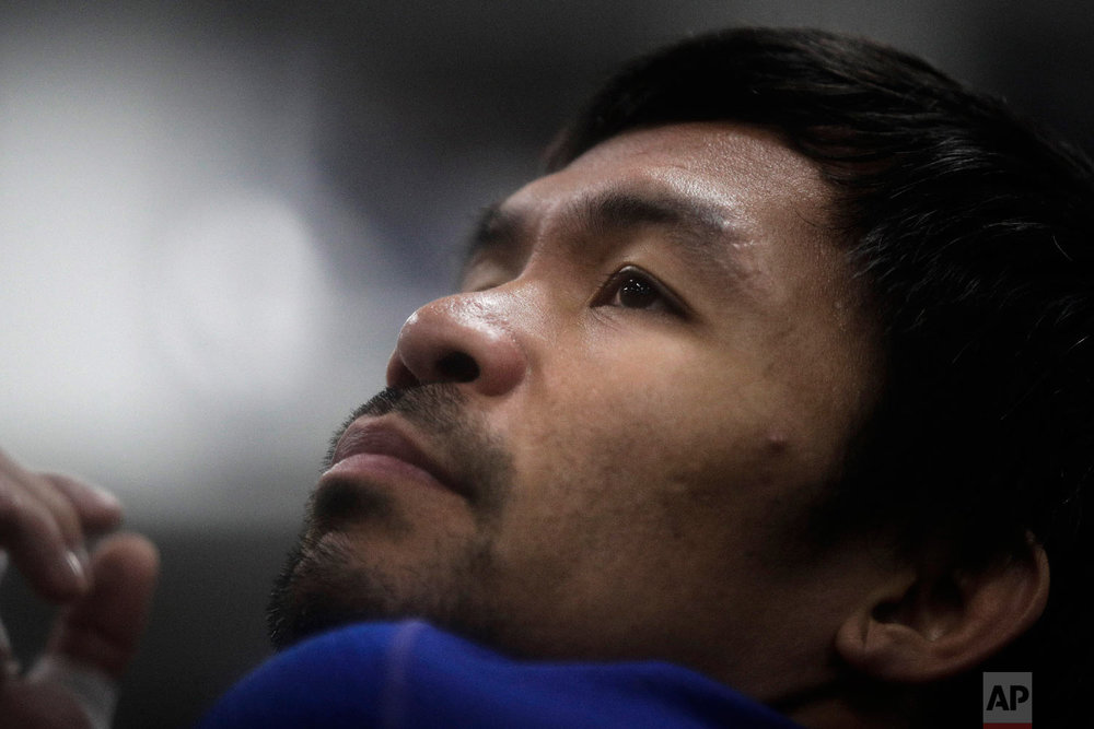 Boxer Manny Pacquiao stretches before his workout at the Wild Card Boxing Club on Jan. 14, 2019, in Los Angeles. (AP Photo/Jae C. Hong)