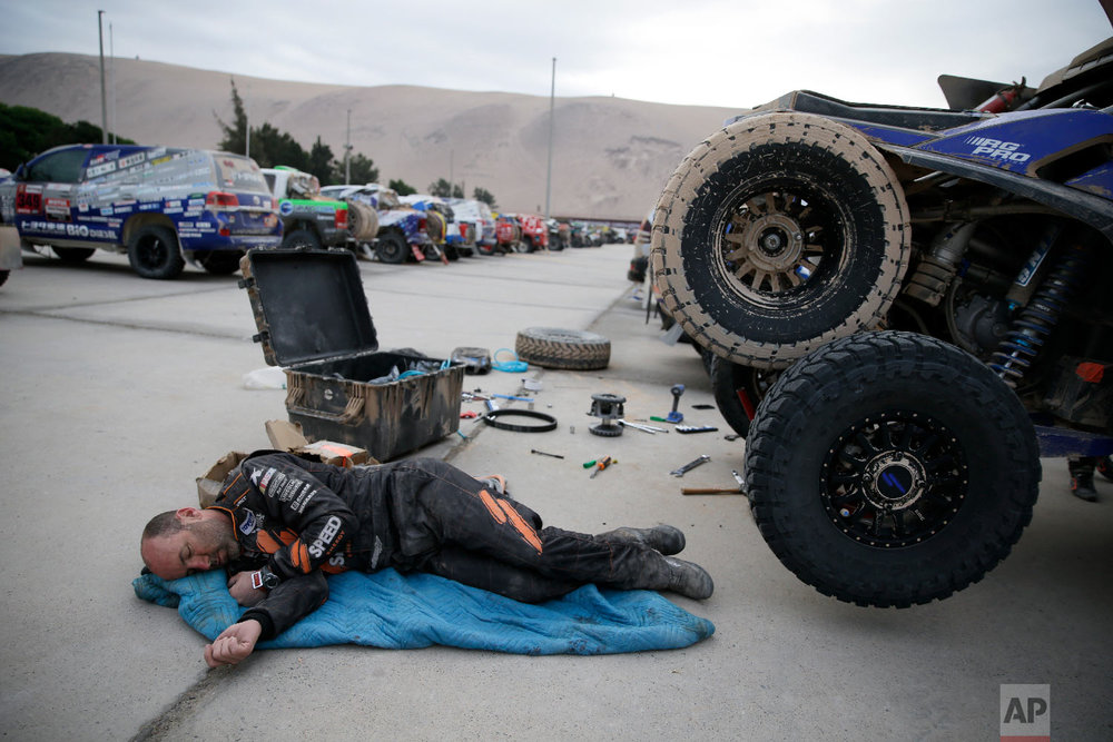 Co-driver Bill Conger, of United States, rests in Peru, Jan. 11, 2019. (AP Photo/Ricardo Mazalan)