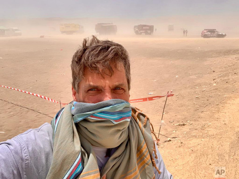 AP photographer Mazalan takes a selfie during a sand storm on the last day of the race, Jan. 17. (AP Photo/Ricardo Mazalan)