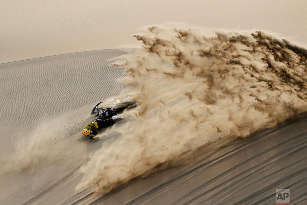 Jan Brabec of Czech Republic falls from his Husqvarna motorbike during the stage nine of the Dakar Rally in Pisco, Peru, Jan. 16, 2019. (AP Photo/Ricardo Mazalan)
