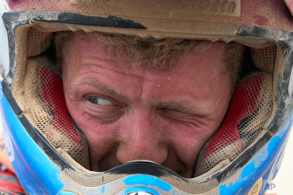 KTM motorbike rider Mark Tielemans stops to refuel in Peru, Jan. 15, 2019. (AP Photo/Ricardo Mazalan)