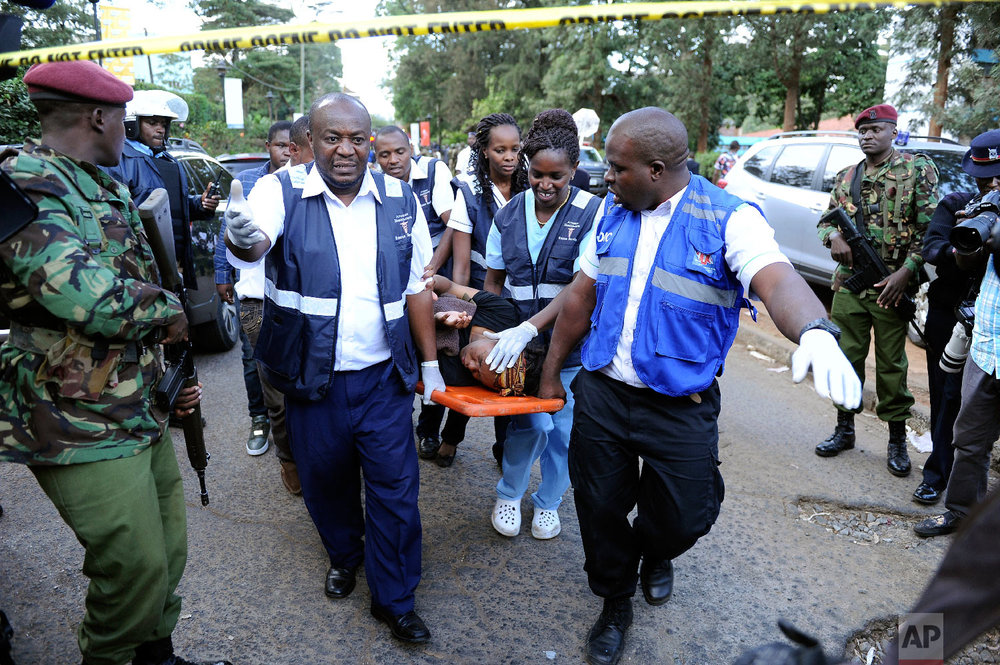 Medics rescue a civilian from the scene at a hotel complex in Nairobi, Kenya Tuesday, Jan. 15, 2019. (AP Photo/John Muchucha)