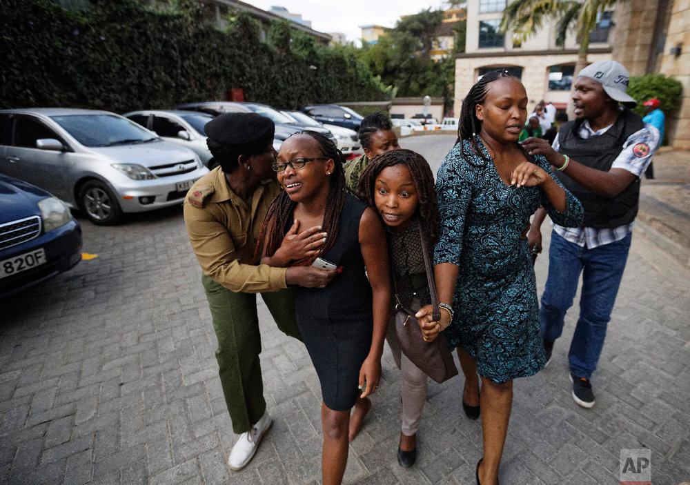 Civilians flee the scene at a hotel complex in Nairobi, Kenya, Jan. 15, 2019. (AP Photo/Ben Curtis)