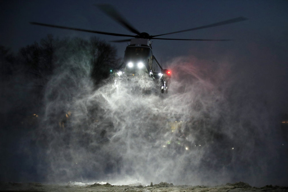 Propellers of the Marine One helicopter carrying President Donald Trump kick up snow as it lands on the South Lawn of the White House, in Washington, Monday, Jan. 14, 2019. Trump returned to the White House from a trip to New Orleans. (AP Photo/Manuel Balce Ceneta)