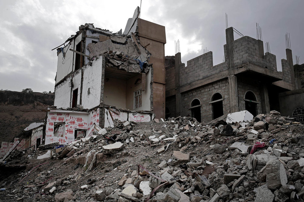 This Aug. 2, 2018 photo, shows the home of Bouthaina Mansour Al Rimi who became a symbol of Yemen's conflict, after an air strike by a Saudi-led coalition on Aug. 25, 2017 hit their home, in Sanaa, Yemen. The red marks are made by family members and they commemorate the days since her home was struck. (AP Photo/Nariman El-Mofty)