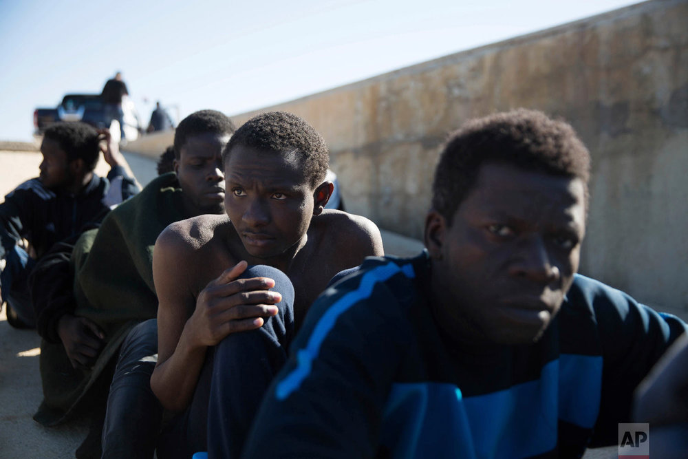 Migrants rest on the sidewalk port of Tripoli they were rescued by the Coast Guard off the coast of Tripoli, Libya, March 3, 2017.  (AP Photo/Mohamed Ben Khalifa)
