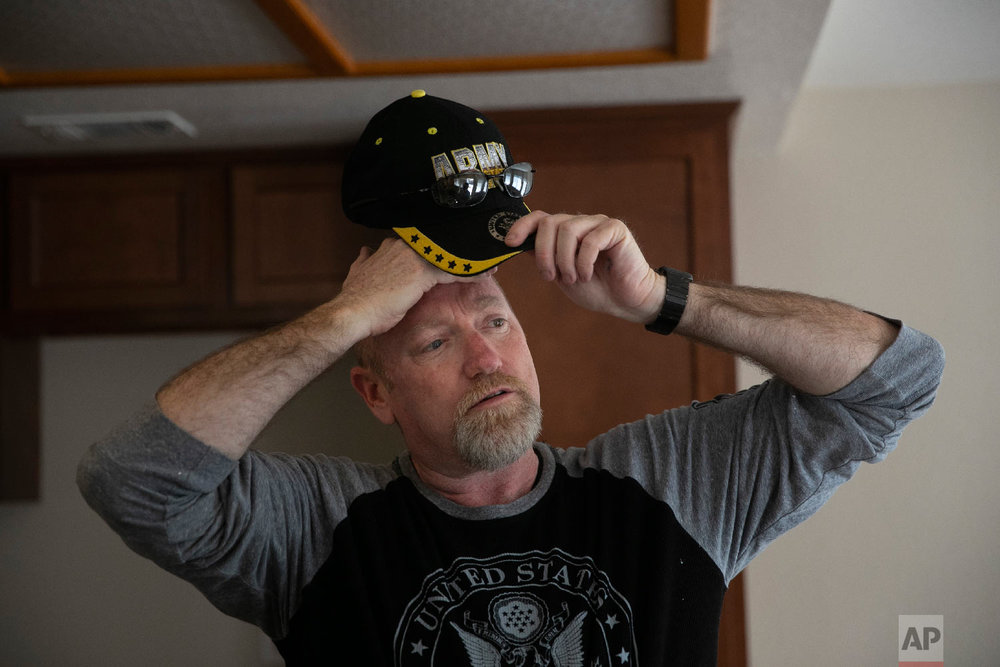 Chris George, a federal employee furloughed from his job as a forestry technician supervisor for the U.S. Department of Agriculture Forest Service, takes a short break while working as a handyman to make ends meet Saturday, Jan. 19, 2019, in Fontana, Calif. (AP Photo/Jae C. Hong)
