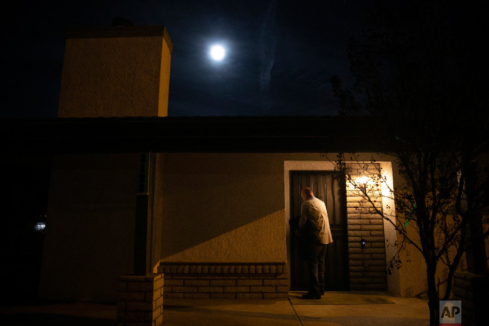 Chris George, a federal employee furloughed from his job as a forestry technician supervisor for the U.S. Department of Agriculture Forest Service, leaves his home for a free meal offered to federal workers affected by the government shutdown Saturday, Jan. 19, 2019, in Hemet, Calif. (AP Photo/Jae C. Hong)