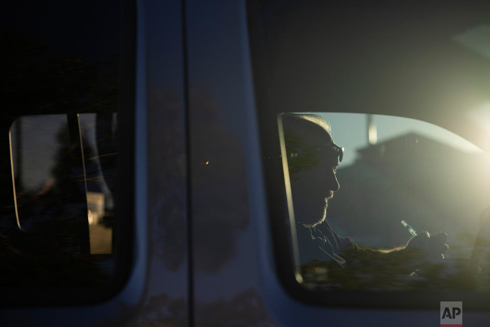 Chris George, a federal employee furloughed from his job as a forestry technician supervisor for the U.S. Department of Agriculture Forest Service, makes a phone call in his pickup truck to set up an interview for a job as a driving instructor Monday, Jan. 21, 2019, in Redlands, Calif. (AP Photo/Jae C. Hong)