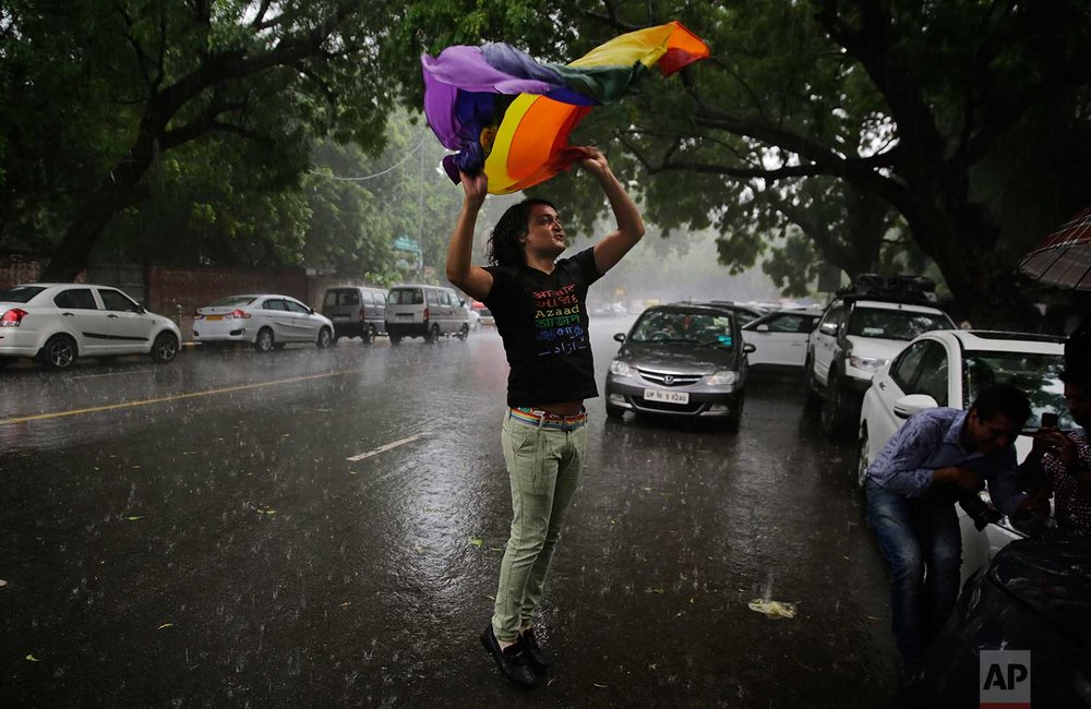 A gay rights activist celebrates after the country's top court struck down a colonial-era law that made homosexual acts punishable by up to 10 years in prison, in New Delhi, India, Thursday, Sept. 6, 2018. (AP Photo/Altaf Qadri)